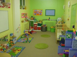 baby-room-combined-with-play-room-design-with-green-interior-color-decorating-ideas-wooden-cradle-carpet-tiles-and-toy-storage